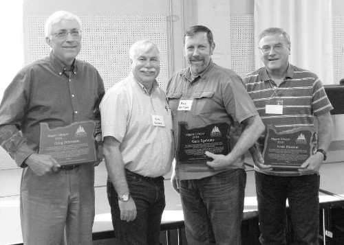 President Rick Barnes presents Riggin' Slinger Awards to Greg Peterson, Gary Springer, and Scott Hanson
